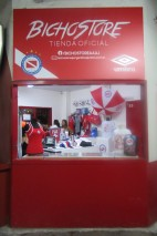 Buying a 700 pesos - £10 - terrace ticket was easy. I had to show a photocopy of my passport at the security check, but I was in. Fantastic. This little shop greeted me. It was a lot more modern than the toilet block opposite.