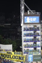 I liked it that Carlos Tevez was playing for Boca Juniors. An old man now, but once a great player. On every spare piece of wall and balcony were banners. this was an incredible feast.