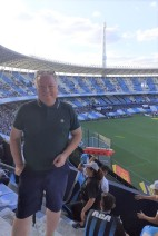 "An hour before the game began, the buzz is already there. Racing play in a 61,000 cylindrical stadium, not dissimilar to the cookie-cutter stadia of the US in the 'sixties. Again, superb seats, but these were ""sit where you want"" unlike at Boca. Again, no away fans."